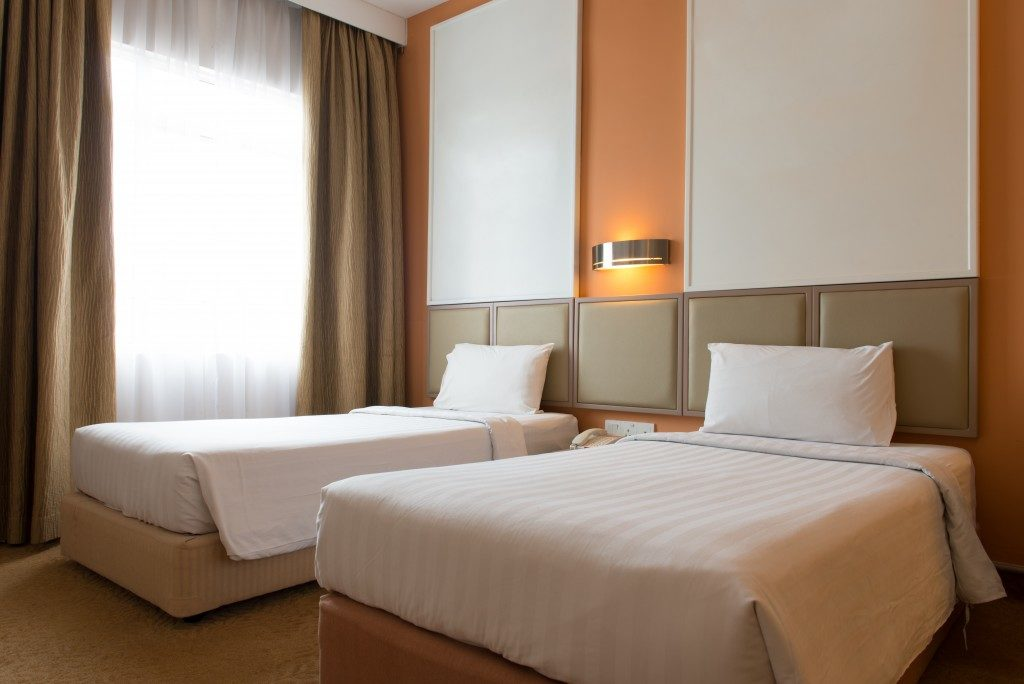 ImageInterior of hotel bedroom with twin size bed