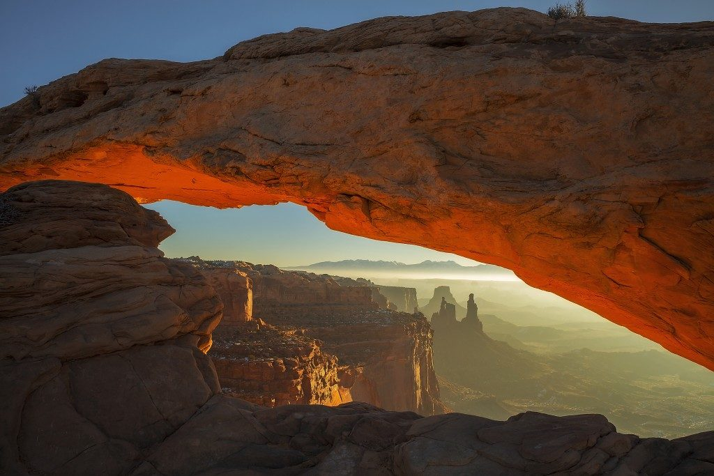 he sun rises at Mesa Arch in Canyonlands National Park, Utah
