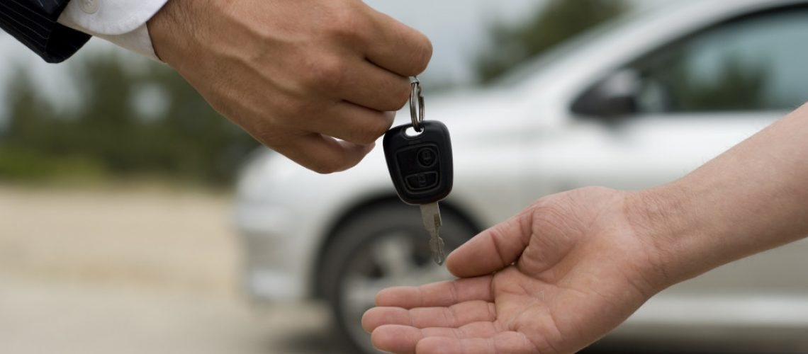 man handing keys to buyer