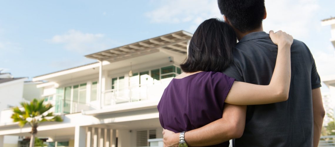 couple infront of their new home
