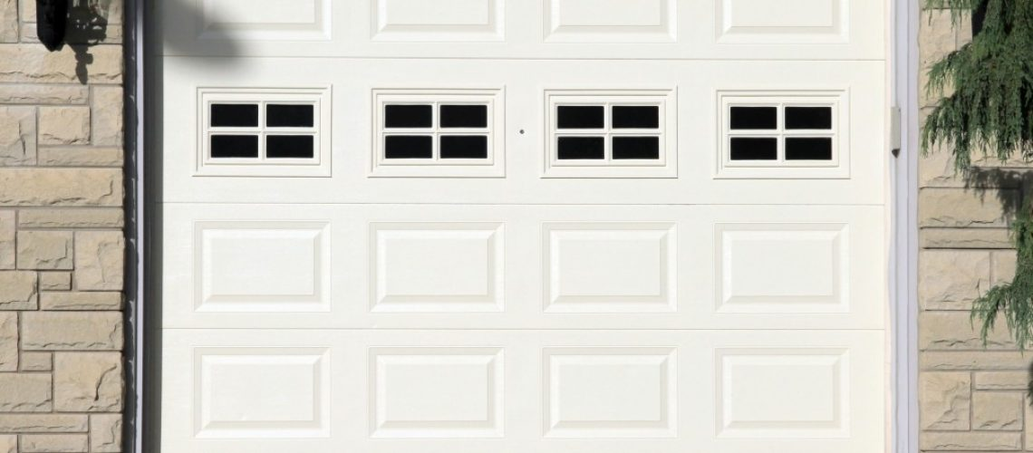 White garage door of a detached house